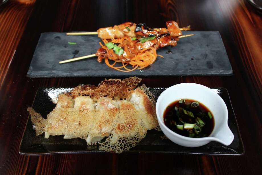 "Highlights of the ""small things"" section of the menu at Kimura are gyozas, with a lacelike cornstarch crust, and yakitori. Photo: Jennifer McInnis / San Antonio Express-News"