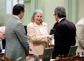 State Sen. Fran Pavley (center) talks with Assemblymen Phil Ting (left) and Richard Bloom.
