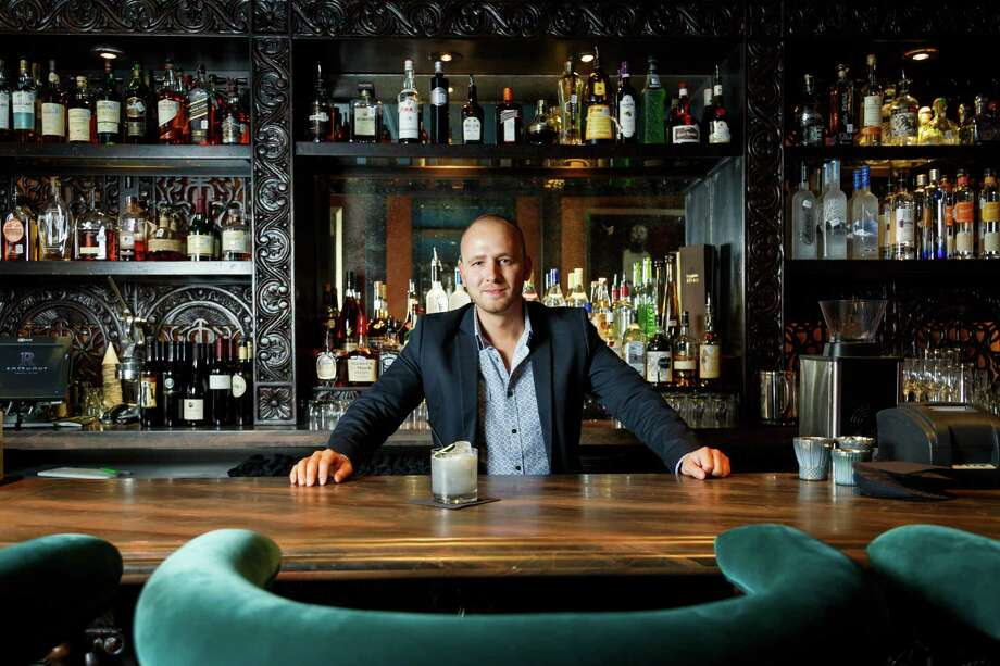 Mixologist Curtis Childress created the modern craft cocktail menu at Rosemont Social Club in Montrose. The bar's rich design features colorful furniture in turquoise and red. Photo: Michael Paulsen, Staff / © 2013 Houston Chronicle