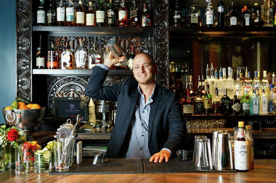 Rosemont Social ClubBartender Curtis Childress makes a drink at Rosemont Social Club, the two-level space - intimate cocktail bar on the ground floor; expansive 