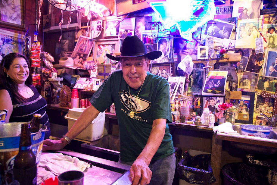Ruben Castro, owner of Ruben's Place, pauses in front of his bar, which features extensive memorabilia that he has been putting together for years. Photo: Xelina Flores-Chasnoff / For The Express-News