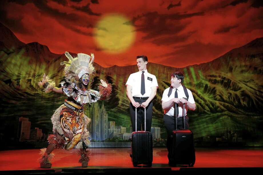 Elder Price (Mark Evans, center) and Elder Cunningham (Chris O'Neill) face challenges while on mission to Uganda in the irreverent Tony-winning musical. Photo: Courtesy Photo