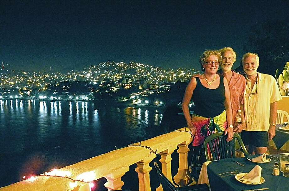Debby (left), Tom and Terry Ferrer enjoy nightlife with Mexico's Pacific coast and the lights of Zihuatenejo as a backdrop during a winter visit. Photo: Courtesy Terry Ferrer