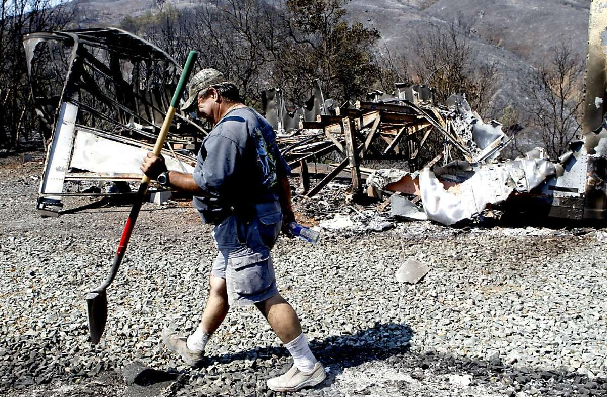 Diablo Bowman member, Kent Swindell, near Clayton, Calif. on Tuesday Sept. 10, 2013, walks past a storage trailer that was burned up in the Morgan Fire destroying $35,000 worth of archery equipment. The archery club was founded in 1964. The Morgan Fire on the eastern slopes of Mt. Diablo is beginning to come under control as firefighters have contained forty five percent of the blaze as of 7 a.m. this morning.