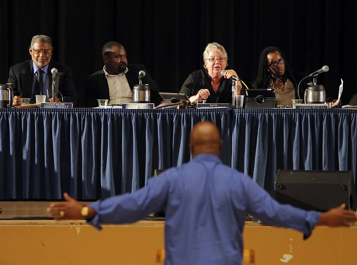 Resident Morris LeGrande gets into a heated discussion during the City Council hearing on Tuesday night.
