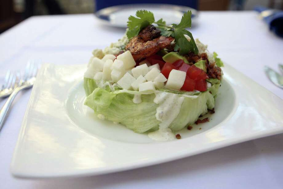 Enjoy an Ostra Cobb salad in a relaxing River Walk atmosphere.