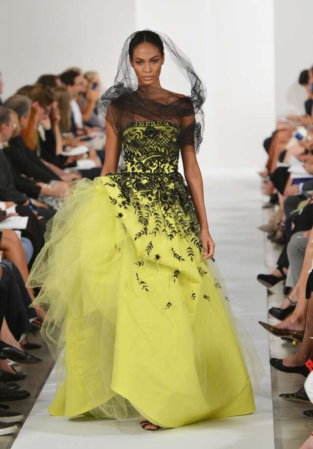 Model Joan Smalls walks the runway at the Oscar De La Renta fashion show during Mercedes-Benz Fashion Week Spring 2014 on September 10, 2013 in New York City.  (Photo by Slaven Vlasic/Getty Images) Photo: Slaven Vlasic, Getty Images