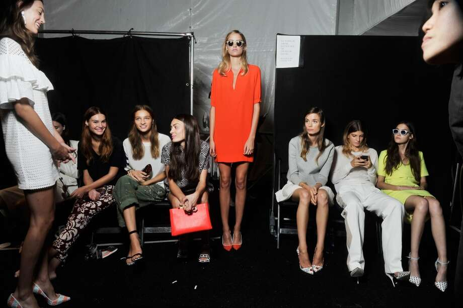 Models prepare backstage before the J.Crew presentation during Spring 2014 Mercedes-Benz Fashion Week at The Studio at Lincoln Center on September 10, 2013 in New York City. Photo: Wendell Teodoro, WireImage