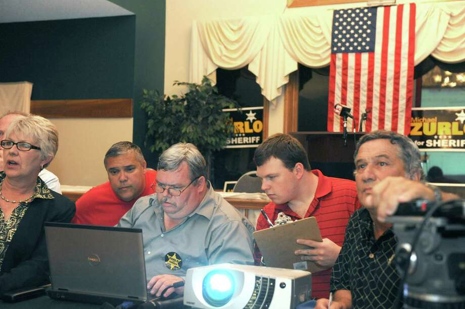 Saratoga County Sheriff Republican candidate Mike Zurlo supporters keep track of election results as they trickle in at the Fairways of Halfmoon on Tuesday night, Sept. 10, 2013, in Halfmoon, N.Y. (Michael P. Farrell/Times Union) Photo: Michael P. Farrell