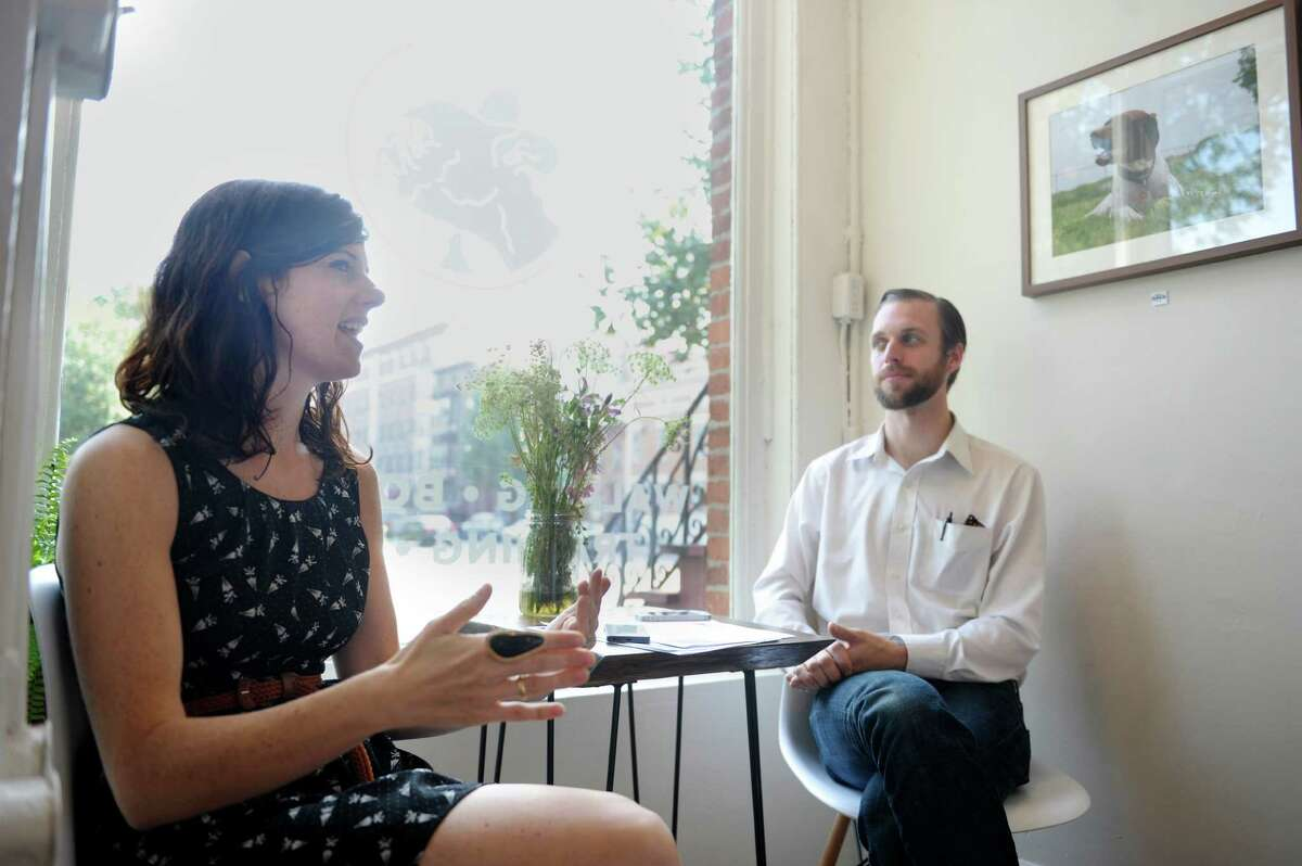 Hounds on the Hudson co-owners Jen Guidice and her husband Michael Guidice talk about recent vandalism at their new Madison Avenue storefront during an interview Wednesday, Sept. 11, 2013, in Albany, N.Y. (Paul Buckowski / Times Union)