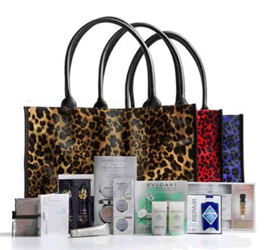 "Neiman Marcus's ""Beauty Event,"" through Sept. 22, gives a gift-bag full of cosmetics-floor goodies with a $125 cosmetics or fragrance purchase and a leather Rebecca Minkoff cosmetics bag with a $500 purchase. Photo: Neiman Marcus"