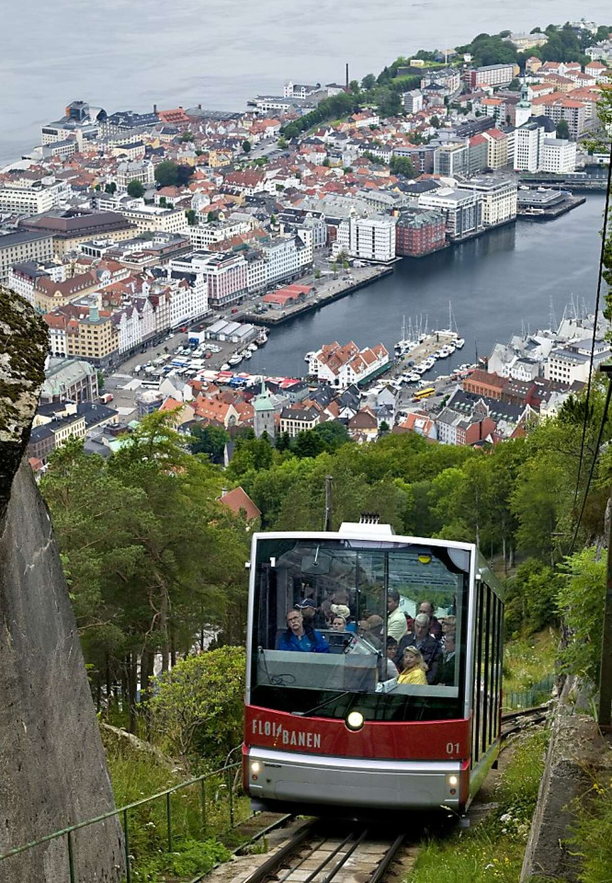 Floien cablecar ascending Floyen hill with Bergen harbour in background.