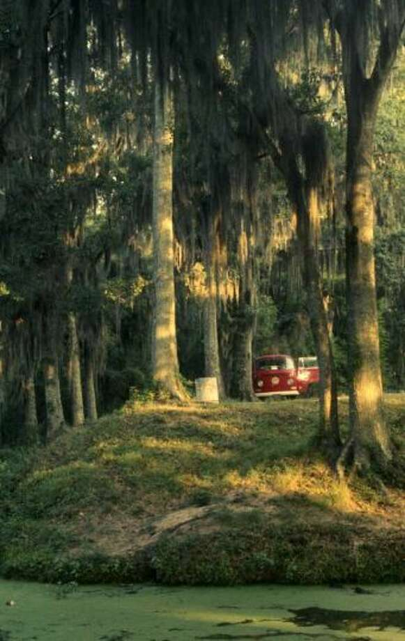 ''This was taken in the early summer of 1970, at a campground somewhere west of New Orleans, as we were beginning to head out of Louisiana toward Texas. The ambiance of the place was just the way it looks: dank, heavy moss hanging down from the trees, moss and lichen growing in the water, frogs and birds and various other animals croaking and chirping and chattering away. We were the only ones in the campground; it was peaceful and pretty, but I was happy to be leaving the next morning...'' - Ed Yourdon, VW owner Photo: Ed Yourdon, Flickr