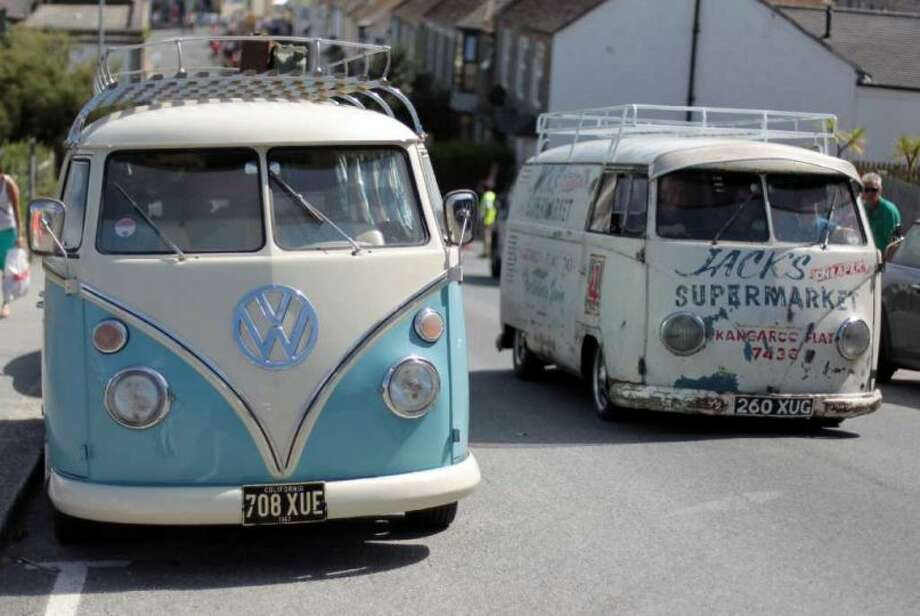 A vintage VW van passes a VW campervan parked near Fistral beach at the site of the Newquay Relentless Boardmasters festival on August 5, 2010 in Newquay, England. Photo: Matt Cardy, Getty Images