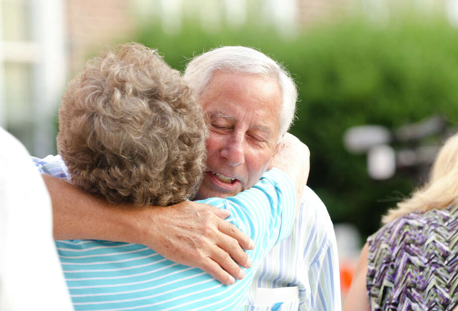 Ralph Sabbag, of Greenwich, hugs a friend during Greenwich September 11th Remembrance memorial at Greenwich Town Hall on Wednesday, Sept. 11, 2013. Sabbag's son, Jason Sabbag, 26, worked in the World Trade Center and lost his life in the terrorist attack. The purpose of this event is to honor the memory of the Greenwich residents and all those killed on this day in the twin towers, the Pentagon, and on Flight 93. Photo: Amy Mortensen / Connecticut Post Freelance