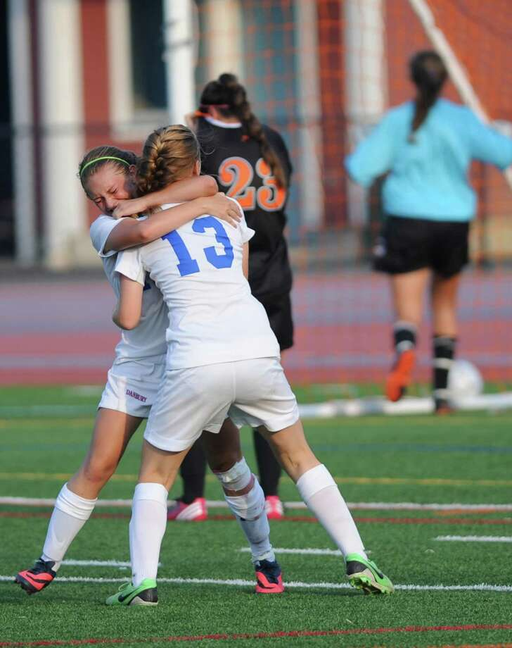Danbury's Brittini Silva, left, celebrates her goal with teammate Delany Daly (13) in Danbury's 3-0 win over Stamford in the girls soccer game at Danbury High School in Danbury, Conn. on Wednesday, Sept. 11, 2013. Photo: Tyler Sizemore / The News-Times