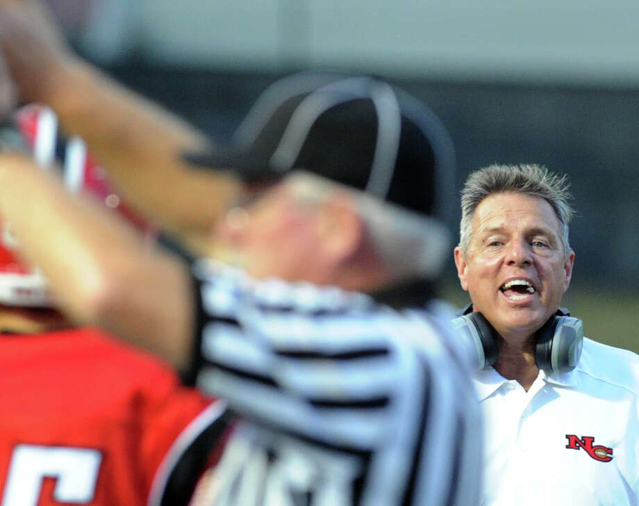 New Canaan Head Football Coach, Lou Marinelli, reacts during the football game between New Canaan High School and Daniel Hand High School, at New Canaan, Wednesday, Sept. 11, 2013. Photo: Bob Luckey / Greenwich Time