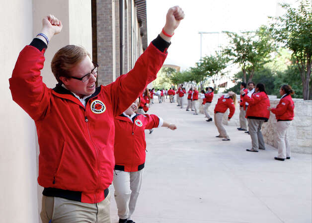 Andrew Bakke, a second year City Year San Antonio AmeriCorps member dances and chants while greeting guest Sept. 11, 2013 to the Henry B. Gonzalez Convention Center for their Opening Day Ceremony. The AmeriCorps members were taking a pledge to help students at 12 different city schools for a year. Photo: Cynthia Esparza, For The San Antonio Express-News / SAN ANTONIO EXPRESS-NEWS