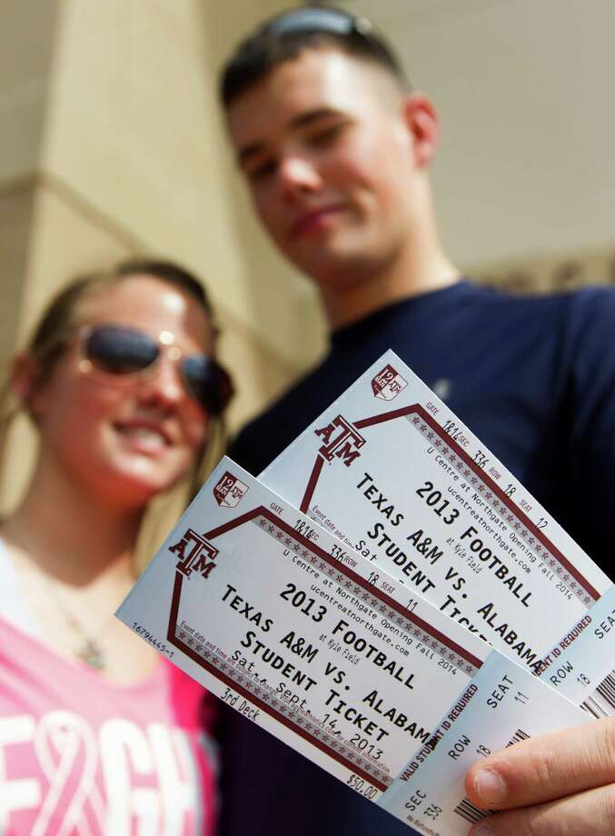 Sophomore Kaley Haney and her boyfriend junior Thomas Franklin pull their student tickets for the Texas A&M/Alabama game on Wednesday, Sept. 11, 2013, in College Station. Kickoff for the game will be at 2:30 p.m. on Saturday at Kyle Field. Photo: J. Patric Schneider, For The Chronicle / © 2013 Houston Chronicle