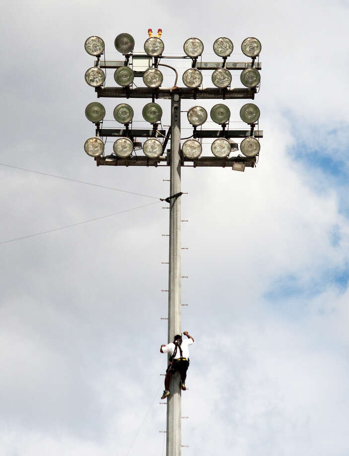 A work crew member hangs a line for a remote camera at Kyle Field on Texas A&M University campus on Wednesday, Sept. 11, 2013, in College Station. The Aggies will face-off against Alabama starting at 2:30 p.m. at Kyle Field. Photo: J. Patric Schneider, For The Chronicle / © 2013 Houston Chronicle