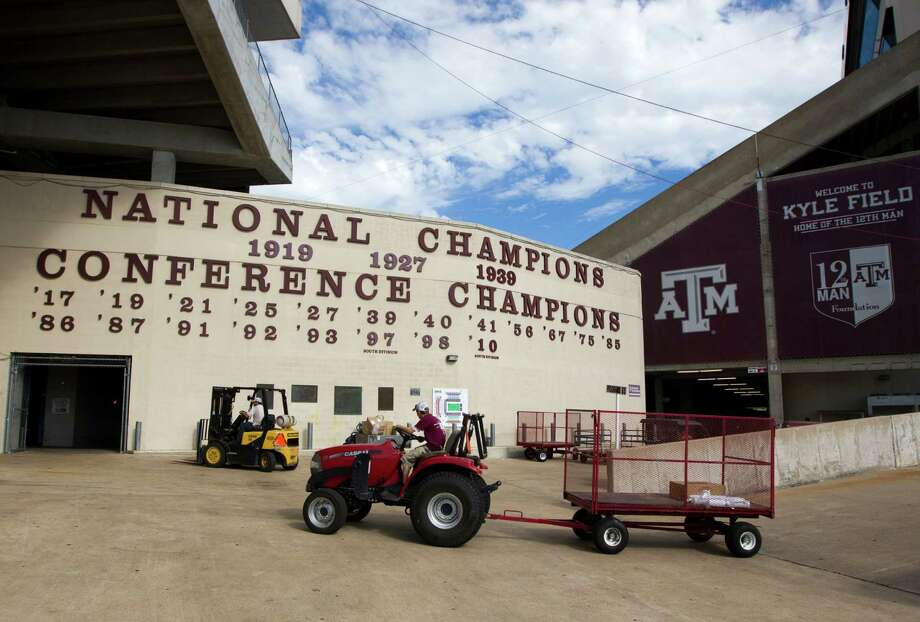 Work crews prepare Kyle Field at Texas A&M University campus on Wednesday, Sept. 11, 2013, in College Station for the A&M / Alabama football game. Photo: J. Patric Schneider, For The Chronicle / © 2013 Houston Chronicle