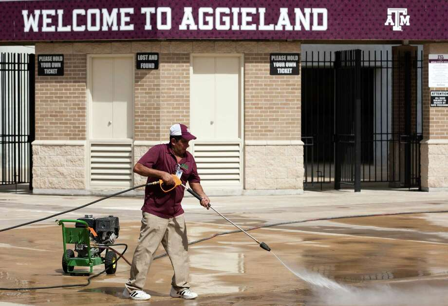 Heraclio Lopez cleans the sidewalks around Kyle Field on Texas A&M University campus on Wednesday, Sept. 11, 2013, in College Station in preparation for the A&M / Alabama football game. Photo: J. Patric Schneider, For The Chronicle / © 2013 Houston Chronicle
