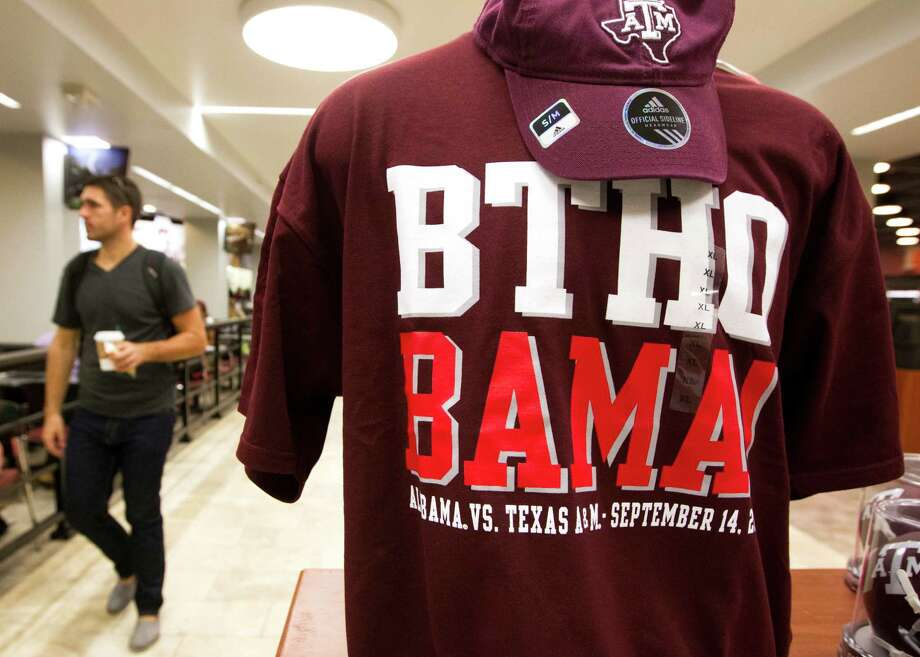 A student walks past a Texas A&M game day t-shirt at the Memorial Student Center Bookstore on Texas A&M University campus on Wednesday, Sept. 11, 2013, in College Station. The Aggies will face-off against Alabama starting at 2:30 p.m. at Kyle Field. Photo: J. Patric Schneider, For The Chronicle / © 2013 Houston Chronicle