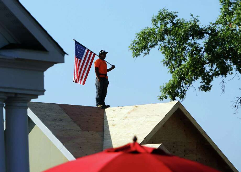 "A worker waits for passing walkers during the 21-mile ""March to the Arch"" memorial walk on Wednesday, Sept. 11, 2013, in Chesterfield, Mo. Wednesday marked the 12th anniversary of the 9/11 terrorist attacks. Photo: Erik M. Lunsford, Associated Press / St. Louis Post-Dispatch"