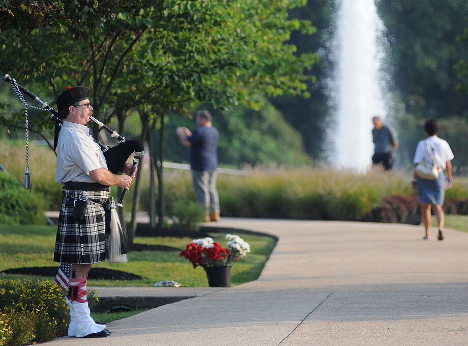 Gary Guth, of Holland, Pa., plays the bagpipes during the Sept. 11 Memorial at the Garden of Reflection on Wednesday Sept. 11, 2013 in Yardley, Pa. Photo: Chloe Elmer, Associated Press / Bucks County Courier Times