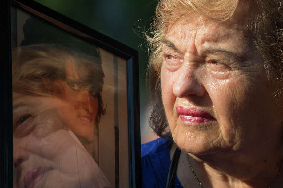 Ester DiNardo, mother of Marisa DiNardo, clutches her image while attending the 9/11 Memorial ceremonies marking the 12th anniversary of the 9/11 attacks on the World Trade Center in New York on September 11, 2013. Photo: ADREES LATIF, AFP/Getty Images / AFP