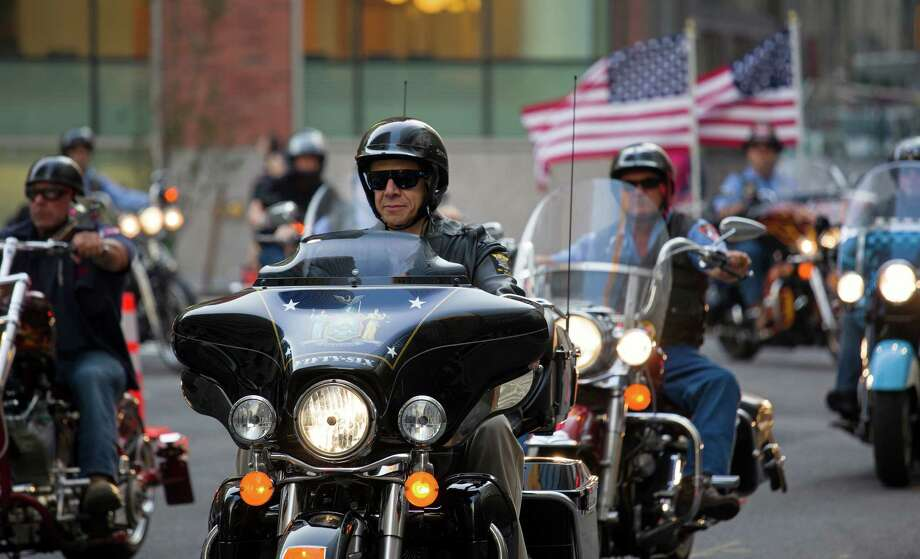 New York Gov. Andrew Cuomo rides with firefighters and first responders with the FDNY Motorcycle Club Wednesday, Sept. 11, 2013, from FDNY Rescue 1 headquarters to the World Trade Center site for the 12th anniversary of the 2001 terrorist attacks. The ride represented the firefighters who responded to the attacks on that day. Photo: Craig Ruttle, Associated Press / FR61802 AP