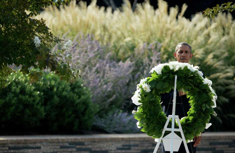 President Barack Obama lays a wreath at the Pentagon, Wednesday, Sept. 11, 2013, during a ceremony marking the 12th anniversary of the worst terror attack on the US. The Pentagon was struck by one of the hijacked plane. Photo: Manuel Balce Ceneta, Associated Press / AP