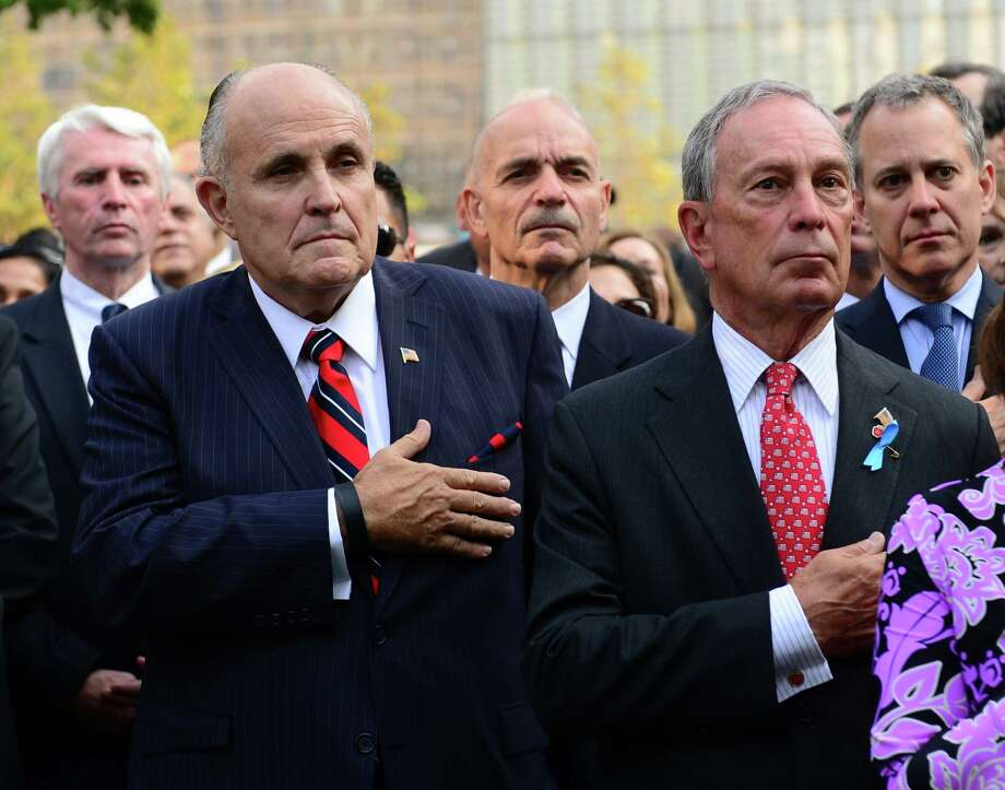 Former New York Mayor Rudolph Giuliani, foreground left, and Mayor Michael Bloomberg, right, attend ceremonies at the 9/11 Memorial marking the 12th Anniversary of the attacks on the World Trade Center, in New York, Wednesday, Sept. 11, 2013. Photo: David Handschuh, Associated Press / POOL The Daily News