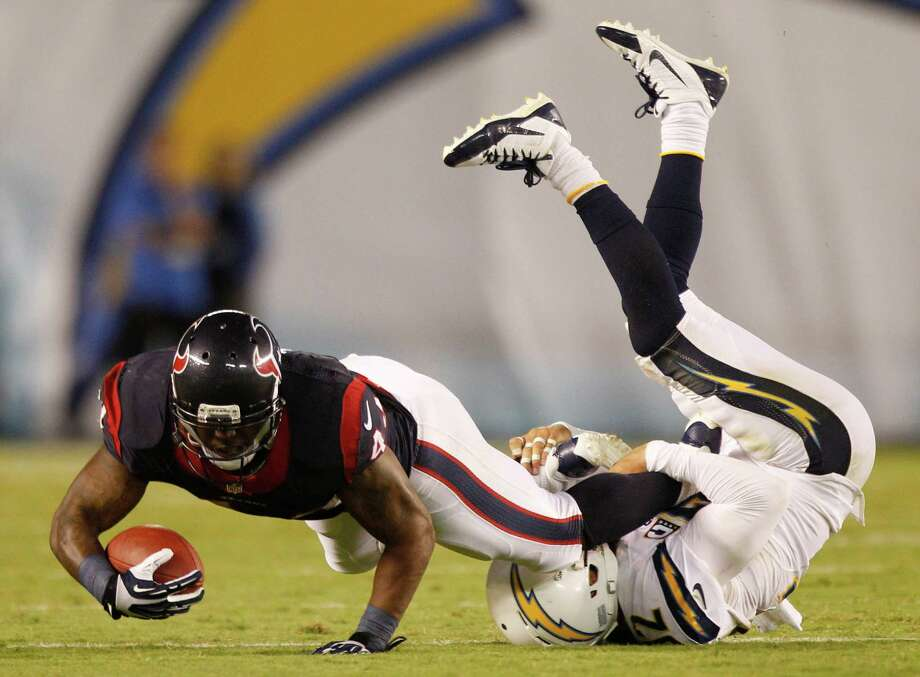Ben Tate, tripped up by Chargers safety Eric Weddle, had 2 fewer rushing yards than Arian Foster on Monday (57-55) but carried the ball nine fewer times. Photo: Brett Coomer, Staff / © 2013  Houston Chronicle