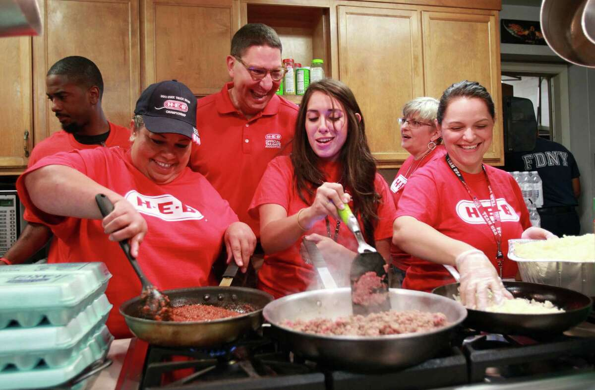 Scott McClelland encourages HEB employees and volunteers Lydia Gonzales, Natalie Barrera, and Angie Silguero, who are cooking breakfast for firefighters at Houston Fire Station #51. The volunteers were cooking as part of a National Day of Service and Remembrance for fallen fire fighters, and also the tragically lost firefighters during a 5 alarm blaze in Houston motel this year. HEB is providing meals for firehouses across the state.