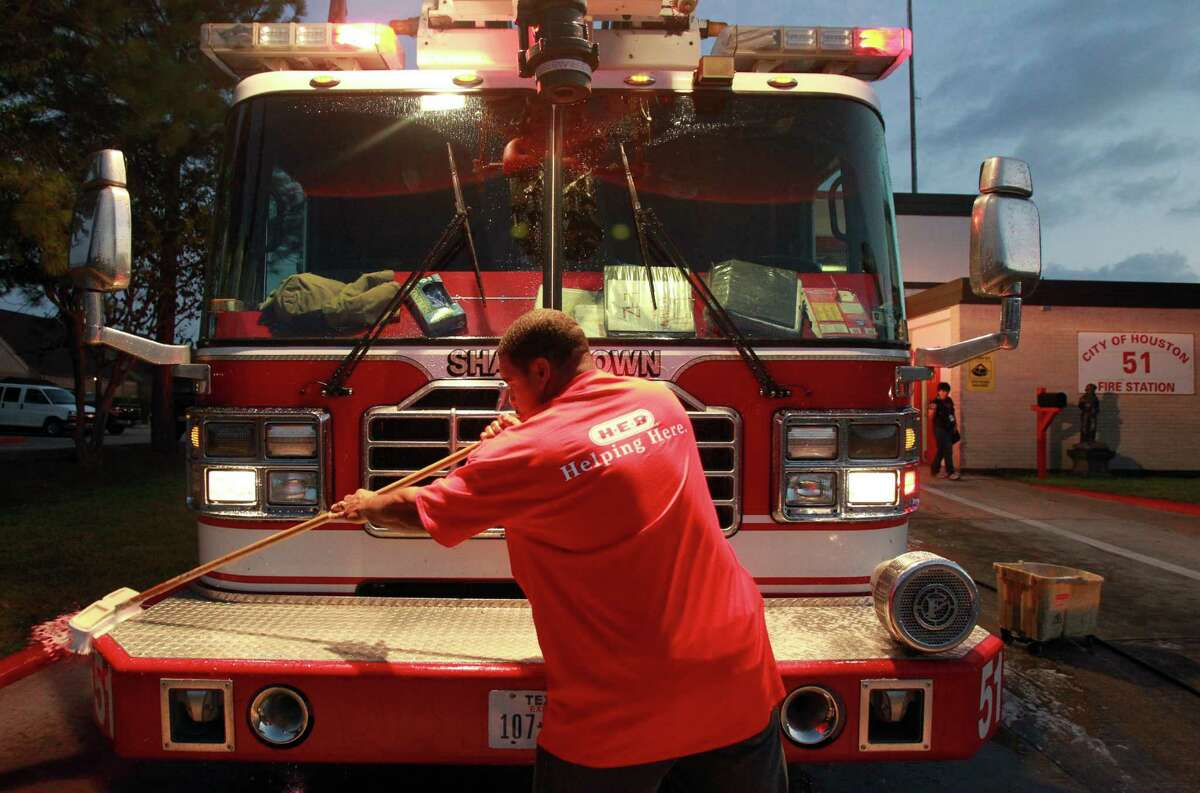 Kendrick Provost, HEB employee, volunteered to wash the fire truck ladder for firefighters at Houston Fire Station #51.