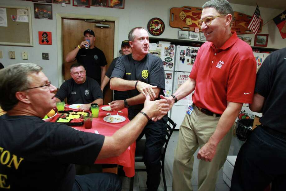 Senior Captian Michael Chittwood and Captain Chad Guest thank Scott B. McClelland while eating breakfast cooked by HEB volunteers at Houston Fire Station #51. Photo: Mayra Beltran, Houston Chronicle / © 2013 Houston Chronicle