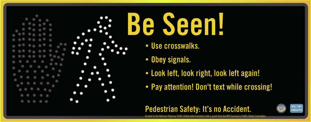 Pedestrian safety posters distributed by DOT to communities and CDTA for a pedestrian/driver awareness campaign on Central Avenue, Albany.