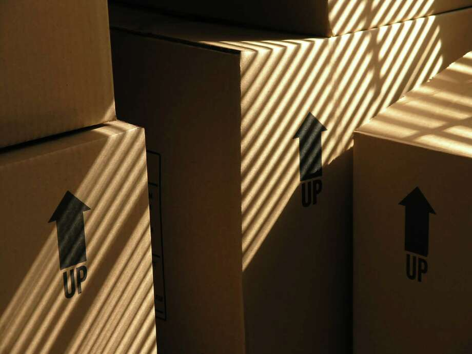 Houston's status as a destination for relocation is moving up, according to a new survey, meaning more boxes like these are being hauled into town containing new residents' belongings. / aberenyi - Fotolia