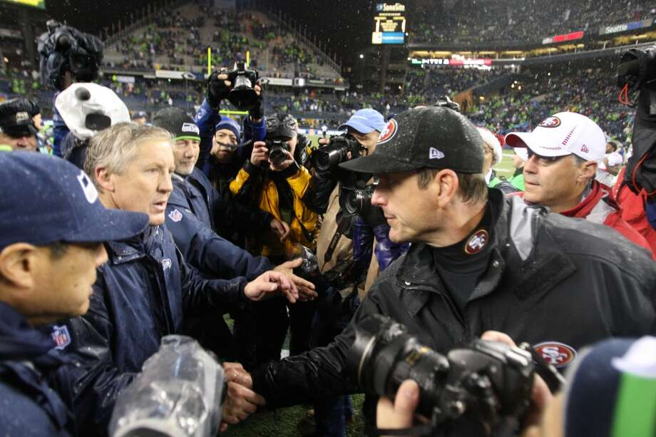 Jim Harbaugh v. Pete CarrollThe Seahawks-Niners rivalry is actually fairly young, but that doesn't make it any less intense. You can trace its origin to the head coaches, who faced each other not long ago as college rivals, Seattle's Pete Carroll at the helm of USC and San Francisco's Jim Harbaugh in charge at Stanford. In fact, you can trace the origin back to one game in 2009, when Harbaugh came into Los Angeles and ran up the score on Carroll's Trojans. ''Look at them all runnin' out,'' Harbaugh was caught on TV saying as he walked to meet Carroll at midfield, referring to the exiting Trojans. An unpleased Carroll asked, ''What's your deal?'' Their public feud started then, and they brought with them it to the NFL. Though both would deny any dislike for the other, we know there's some bad blood between these two. Photo: Michael Zagaris, Getty Images