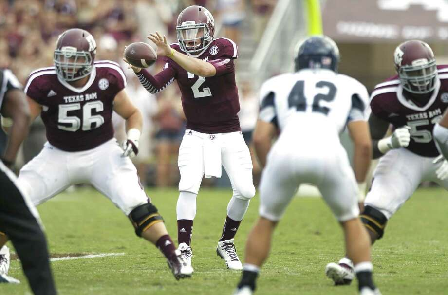 Quarterback Johnny Manziel and the Texas A&M offense have been hot since his season debut in the second half against Rice. Photo: Brett Coomer / Houston Chronicle