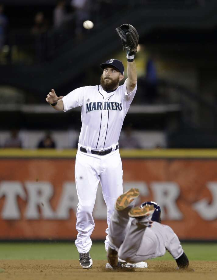 Mariners second baseman Dustin Ackley leaps for the throw as Jonathan Villar slides safely into second base for a stolen base. Photo: Elaine Thompson, Associated Press
