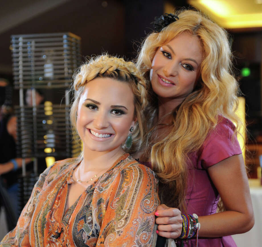 THE X FACTOR:  July 10, 2013 in Los Angeles, CA. L-R: Demi Lovato and Paulina Rubio on the set of THE X FACTOR. CR: Ray Mickshaw / FOX. Copyright / FOX.