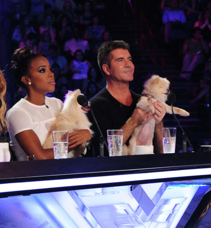 THE X FACTOR:  June 11, 2013: L-R:  Kelly Rowland and Simon Cowell judge contestants with a little help from their friends on the set of THE X FACTOR in New Orleans.  Season three of THE X FACTOR premieres Wednesday Sept. 11 (8:00-9:00 PM ET/PT) and Thursday Sept. 12 (8:00-9:00 PM ET/PT) then airs Wednesday Sept. 18 (8:00-10:00 PM ET/PT) and Thursday Sept. 19 (8:00-9:00 PM ET/PT.)  © Copyright 2013 / FOX
