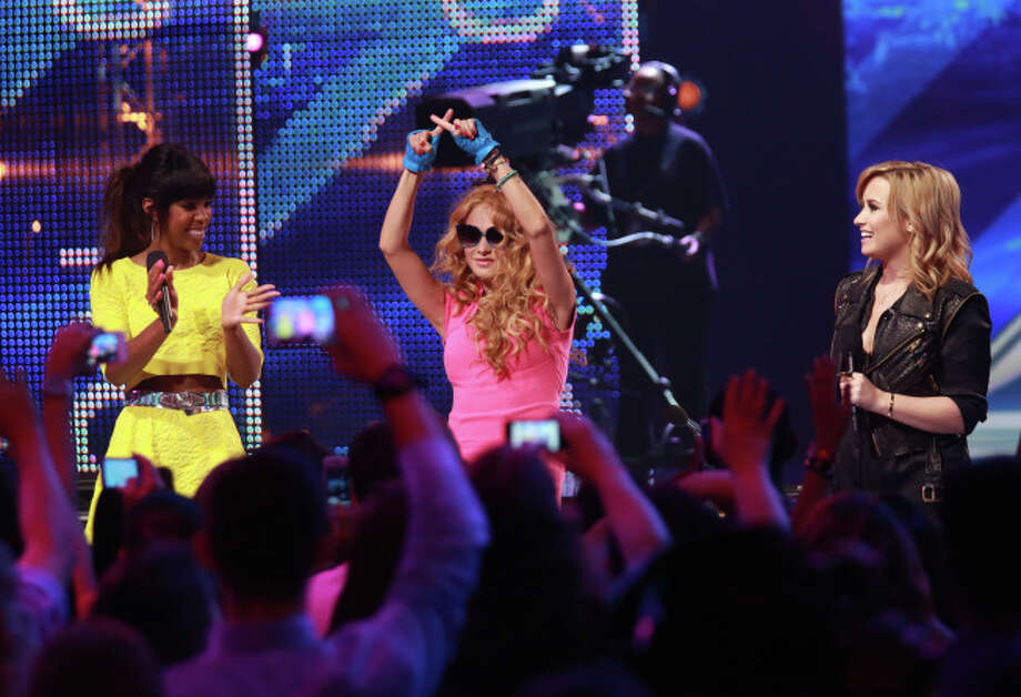 THE X FACTOR:  L-R: Judges Kelly Rowland, Paulina Rubio and Demi Lovato in Charleston, SC, on THE X FACTOR on FOX.  Season three of THE X FACTOR premieres Wednesday Sept. 11 (8:00-9:00 PM ET/PT) and Thursday Sept. 12 (8:00-9:00 PM ET/PT) then airs Wednesday Sept. 18 (8:00-10:00 PM ET/PT) and Thursday Sept. 19 (8:00-9:00 PM ET/PT.)  CR: Ray Mickshaw / FOX. © Copyright 2013 / FOX