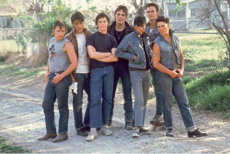 The 1983 film 'The Outsiders,' directed by Francis Ford Coppola and starring a slew of not-yet-famous actors like Emilio Estevez, Rob Lowe, C. Thomas Howell, Matt Dillon, Ralph Macchio, Patrick Swayze and Tom Cruise, was based off a book by S. E. Hinton. Photo: AP