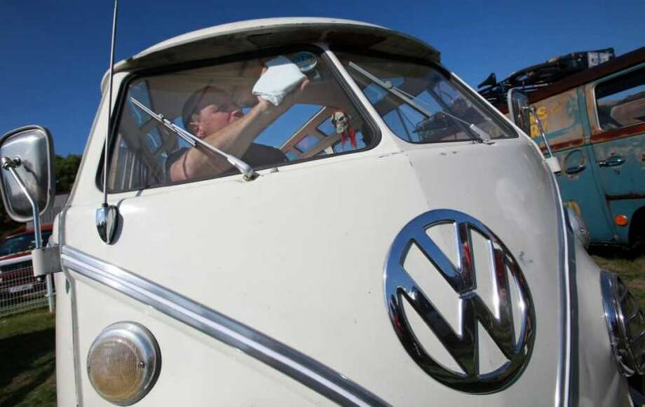 A Colin Pace cleans the inside of his 1966 Volkswagen van at the 2009 Vanfest at the Three Counties Showground on September 13, 2009 in Malvern Wells, England. Photo: Matt Cardy, Getty Images