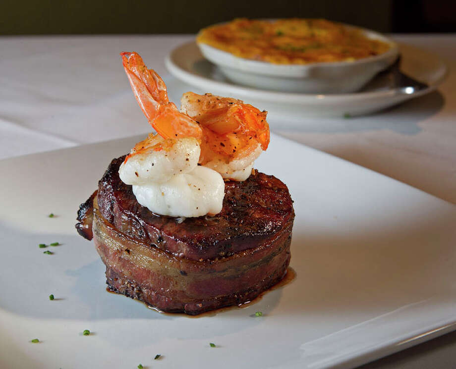 8. Killen's Cuisine: Steakhouse Dish: Nueske bacon-rrapped filet with two jumbo grilled shrimp Entree price range: $$$-$$$$ Where: 2804 S. Main Phone: 281-485-0844 Website: killenssteakhouse.com Read Alison Cook's review of Killen's. Photo: James Nielsen, Chronicle / © 2011 Houston Chronicle