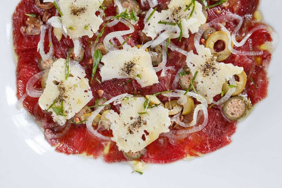 10. Cove Cold Bar Cuisine: Seafood Dish: carpaccio with lamb heart, lemon vinaigrette, herbs, sea salt, tellicherry pepper, parmesan, caperberry and shallot Entree price range: $$ Where: 2502 Algerian Way Phone: 713-581-6101 Website: havenhouston.com Read Alison Cook's review of Cove Cold Bar. Photo: Michael Paulsen, Houston Chronicle / © 2013 Houston Chronicle
