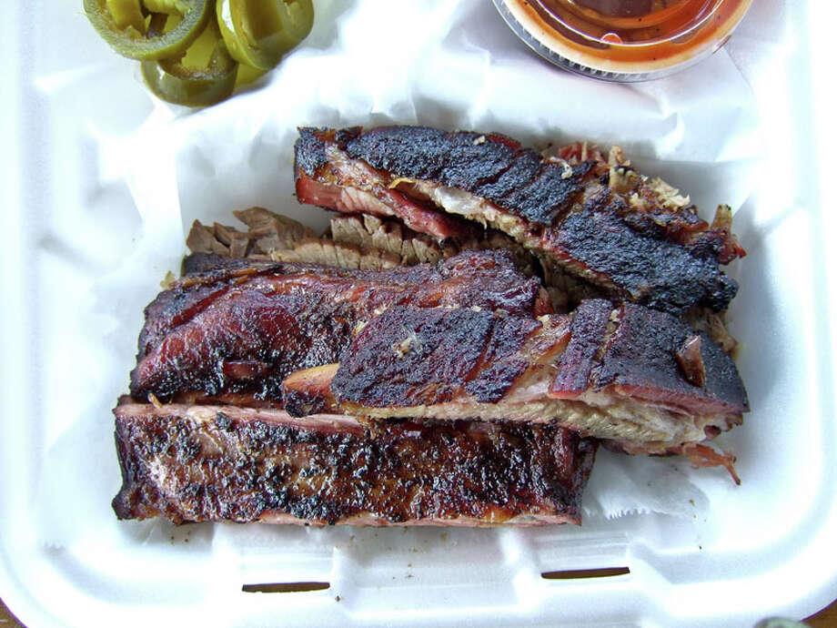 36. Gatlin's BBQCuisine: barbecueDish: pork ribsEntree price range: $Where: 1221 W. 19thPhone: 713-869-4227Website: gatlinsbbq.comRead Alison Cook's review of Gatlin's BBQ. Photo: J.C. Reid
